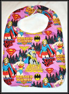 Batgirl, Wonder Woman, Super Girl Cotton Bib with White Terry Cloth - Geek-a-bye Baby -- Comic Geek - Handmade, Retro DC Comics. $10.00, via Etsy.