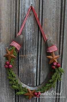 Rusty pre-used horseshoe ready for the holidays with gingham tie (tan or red) and embellishments as shown.