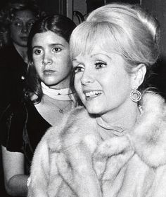 An updo and a mink-What else could a girl want? Carrie Fisher and Debbie Reynolds New York City- November 6, 1972