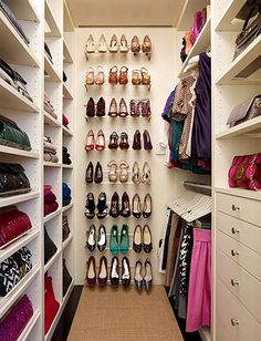 Install wall mounted shoe racks to the back wall of your closet. Great way to utilize closet space!