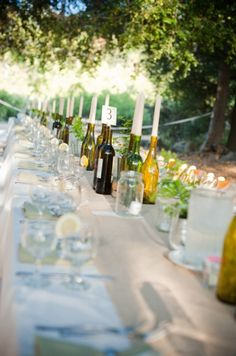 wine bottle centerpieces - only clear of course, thoughts on with/without the candle?