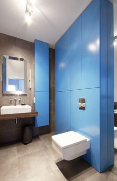 Industrious Look Applied in Minimalist Apartment : Baby Blue Inset Wall From Poland Apartment Bathroom Divider Among White Toilet Also White Ceiling