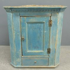 Small blue 18th c. Corner Cupboard with a dentil molding