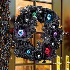 Improvements Lighted Eyeball Halloween Wreath ($40) ❤ liked on Polyvore featuring home, home decor, holiday decorations, halloween wreaths, lighted wreaths, halloween home decor, lighted home decor and rose wreath