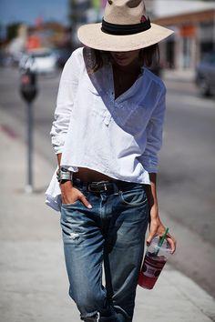 Boyfriend jeans with a breezy blouse + straw hat.