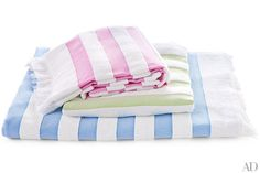 Matouk's Amado cotton beach towels and blankets conjure the breezy chic of the Italian Riviera