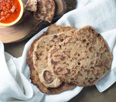 This soft chewy whole wheat naan recipe makes a healthy authentic old world bread. Typically naan is served hot and brushed with butter.