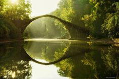 Rakotzbrücke (Rakotz Bridge), popularly known as the Devil's Bridge was built from basalt stones back in in Kromlau, Germany. Because of the unique construction accuracy, the bridge and its reflection merge into a perfect circle, regardless of. Beautiful World, Beautiful Places, Beautiful Pictures, Amazing Photos, Rakotz Bridge, Old Bridges, Brothers Grimm, Colossal Art, Fairy Tail