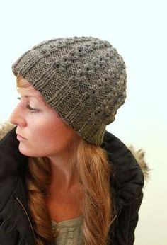 Jane Cabled Hat pattern by Jane Richmond for IDP. Shown in Wool of the Andes in Bramble Heather.