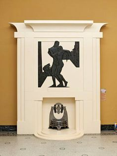Fireplace in the drawing room of Mulberry House, London with Melchett Fire basket Ironwork by Charles Sargeant Jagger, 1930