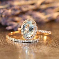 Aquamarine Engagement Ring Petite Diamond Wedding Ring Set in 14k Rose Gold, 9x7mm Oval Aquamarine Ring and Half Diamond Eternity Band by LaMoreDesign on Etsy https://www.etsy.com/listing/194343831/aquamarine-engagement-ring-petite