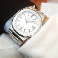 White dial Patek Philippe Nautilus  by scandinavianwatchclub