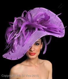 iLarge Violet Sinamay Hat Edged with Swarvoski Crystals, Feathers Front & Back.  This one, I just love.