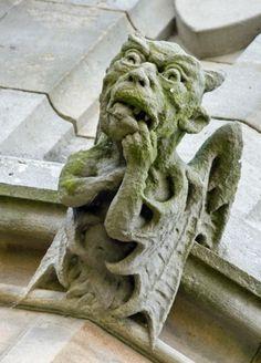 Grotesque ( gargoyle ) on Bamburgh Castle in England