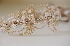 Porcelain Rose Headdress made from tiny handmade porcelain roses in white and palest pink @fineartweddingboutique
