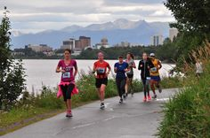 2013 Great Places in America: Public Spaces – Tony Knowles Coastal Trail, Anchorage, Alaska • Competitors in the Big Wild Life Runs, an event held on the Tony Knowles Coastal Trail, with the Anchorage skyline behind them. Photo courtesy Jody Overstreet. http://www.planning.org/greatplaces