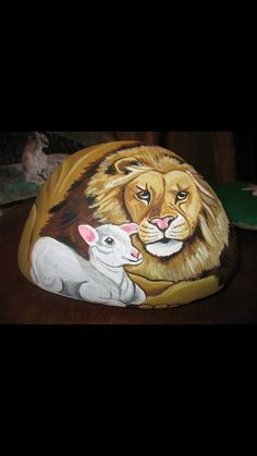 Lion and the Lamb painted rock by Kristinsart4u on Etsy, $30.00
