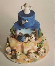 Cake covered with fondant and colored with air-brush. All figures are made from gum-paste.