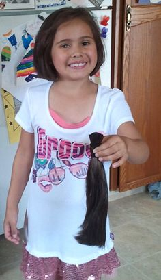 6-year-old Carli Ripplinger donated her hair to people with cancer – and raised $735 doing it!