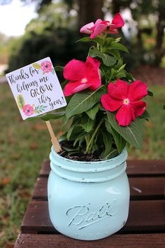 Creating an end of the year teacher gift with flowers.