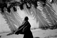 Abbas KENYA. Mombasa. A woman in nigab, the full Islamic veil in the Muslim quarters of the city.