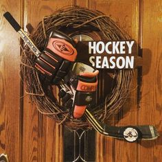 I made this Hockey season wreath. Grapevine wreath, old stick and gloves... Hot glue gun and done!