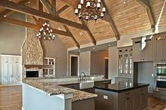 Rustic Dream Kitchen! Two stories with exposed beams. What a great design for a lake home. #PatsyW #lakehomes #funcookingspaces