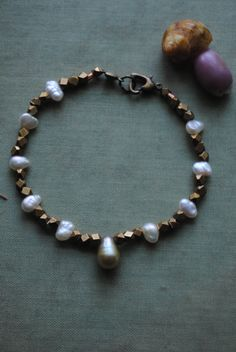 "Modern Brass Fresh Water Pearl Bracelet/ by ArcaneMemory on Etsy, ""Stunna"" Beautiful fresh water pearls paired with gorgeous brass nuggets and a heart-shaped clasp.  If you would like to know more about this bracelet please feel free to visit my shop; arcanememory.etsy.com"