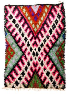 Boucherouite rug hand-loomed by Berber women from recycled remnants, including cotton, synthetic fibers, nylon, Lurex, and even wool and plastic
