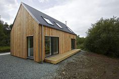 Prefab-5-r-house-rural-design --- Rural Design Architects designed the R.House situated on Scotland's Isle of Skye as an affordable housing solution in the Highlands and Islands of Scotland. While modern, they do reflect traditional Highland barns and steadings of the area.