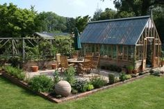 Green House idea love the surrounding gardens as edges thinking this will be great at my house with herbs