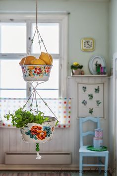 lovely plant hangers. Use vintage metal cooking pots