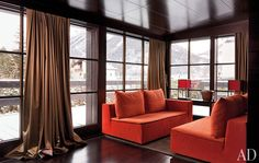 Using dark mahogany instead of golden pine, transforms Saint Moritz retreat into a couture take on traditional alpine style