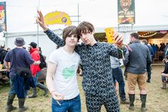 Miles Kane (wearing pyjamas?) has his photo taken with Josh from The Strypes in the backstage bar.