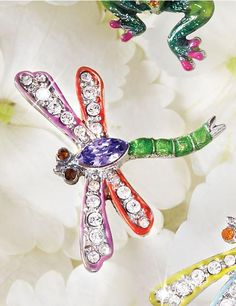 Emily Dragonfly Pin - Fuschia: Delightful bejeweled critters stand ready to adorn your lapel, shoulder, or scarf with a dash of fun and sparkle! Each Emily Dragonfly Pin is enameled and set with Swarovski® crystals. Tack pin back and coordinating clutch.