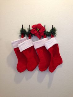 No fireplace to hang stockings?? Just use a coatrack and cover it with garland :)