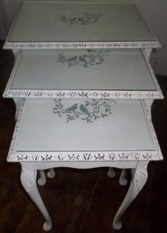 Bespoke nest of tables painted in Annie Sloane's old white with stenciled birds motif