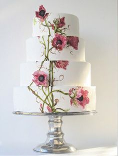 It's an optical illusion! Some of the flowers are painted on the cake and some are three dimensional