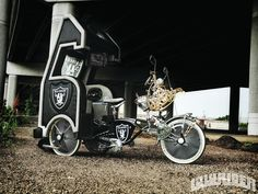 Check out David and Mauro Cante's Oakland Raiders themed custom trike named, Raider Nation. Built from a Schwinn frame, Raider Nation has a custom tailgate-type rear complete with speakers and televisions. Raiders Football Team, Nfl Oakland Raiders, Raiders Cheerleaders, Nfl Football, Raiders Stuff, Raiders Girl, Raiders Emblem, Raiders Wallpaper, Lowrider Bicycle