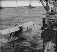 BRITISH SHIPS FIRST WORLD WAR (SP 1141)   A Sopwith Schneider seaplane (serial 1557) being hoisted aboard the cruiser HMS UNDAUNTED.