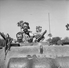 Captain Weir and Corporal Picken in the turret of their Sherman tank, 'Cairngorm', 116th Regiment, Royal Armoured Corps, between Taungtha and Meiktila, 15 March 1945.