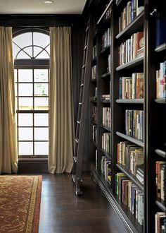 Dramatic dark charcoal bookshelves with rolling library ladder!