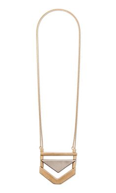 Long tribal pendant necklace in matte gold and silver-plated brass. Great for layering!