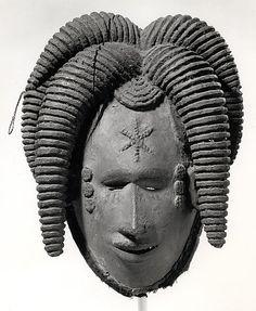 Igbo Peoples Mask, Nigeria: Female (Mmuo). Ca. 19th–20th century. Wood, pigment, cloth, wire, thread, encrustatio...
