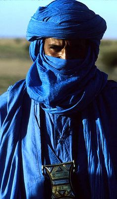 Beautiful indigo scarves and headdresses are worn by the touareg men to protect them from the sand in the desert.