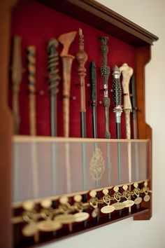 A display case of Harry Potter wands. <3