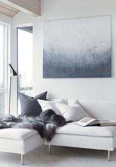 NATURAL RUGS - White sofa and sheepskin throw in the Norwegian home of Nina Holst / Stylizimo. ICELANDIC- LONG HAIR GREY.