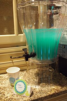 """Wyatt's birthday Blue Kool-Aid mixed with ginger ale for a slightly zingy """"ocean water"""" drink. We used this for our whale birthday party, but it would be great for an under the sea or ocean themed party too. Whale Birthday Parties, Double Birthday Parties, Cousin Birthday, Baby Boy First Birthday, Birthday Ideas, 4th Birthday, Ocean Party, Under The Sea Party, Ginger Ale"""