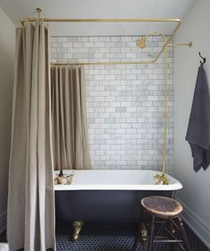 While we'd all love a glass-walled splash room or Crittall doors, we don't all have the budget or space. It might not be your first choice but we're here to show you how to make a bathroom with a shower curtain look cool.