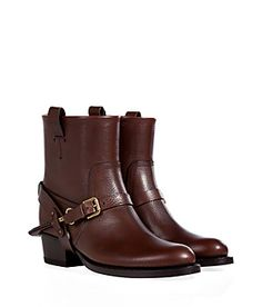 "Rendered in rich brown leather with an edgy buckled spur-like strap, Ralph Lauren Collection's ""Isara"" boots add a touch of attitude to causal looks #Stylebop"